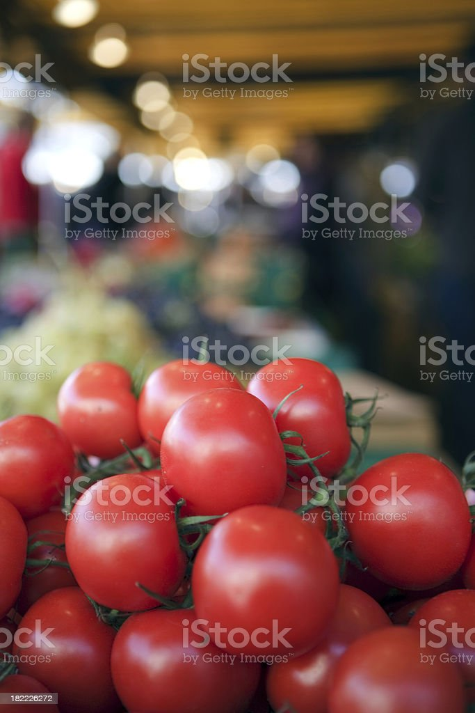 Red ripe tomatoes on the counter market royalty-free stock photo