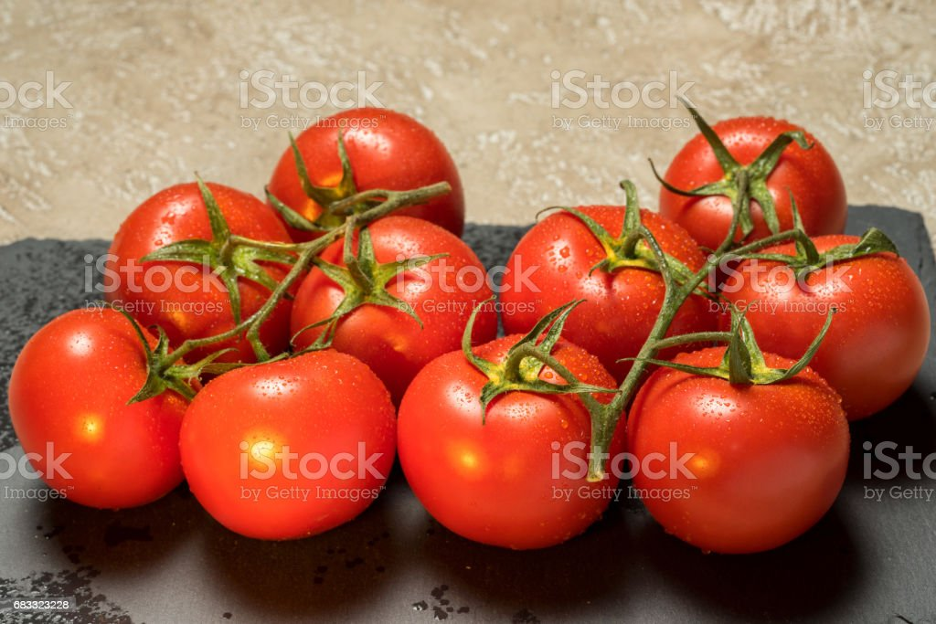 red ripe wet whole tomatoes royalty-free stock photo