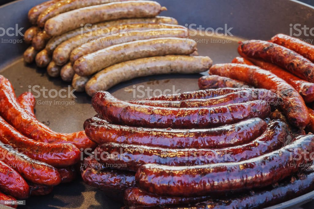 Red roasted sausages on large pan. stock photo