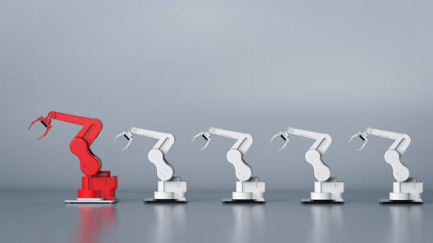red robotic arm as a leader stock photo