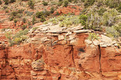 Desert red rock cliff face shows eroded stratification in remote back country canyon.  Yavapai County, Arizona, 2013.