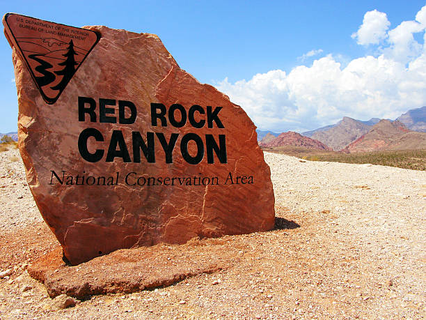 red rock canyon entrance sign on rock, nevada - red rocks stock pictures, royalty-free photos & images