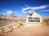 Red Rock canyon sign at the in front of the Red rock mountains