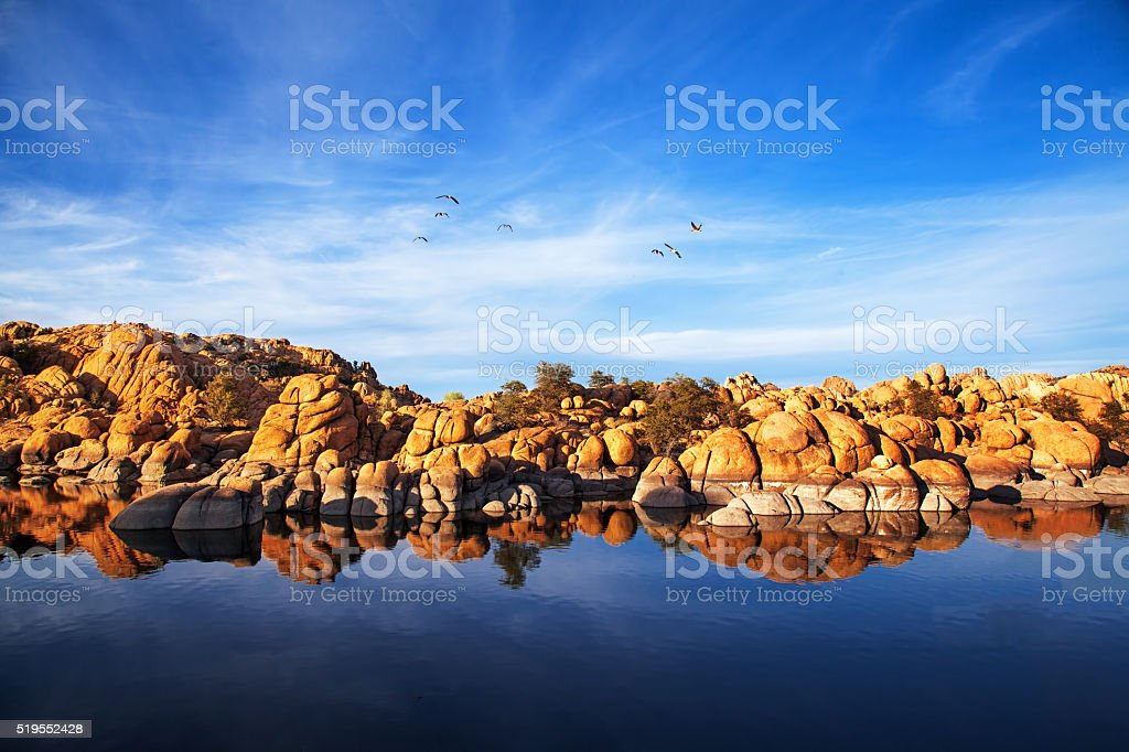 Red Rock Reflection On Arizona Lake stock photo