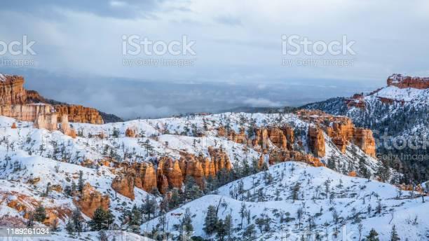 Photo of Red rock towers hoodoos of Bryce Canyon/Cedar Breaks in new snow after winter storm in Utah