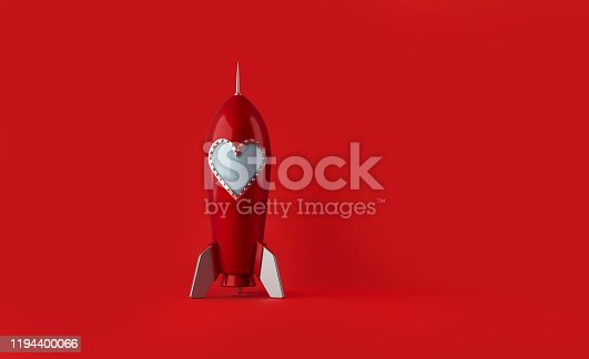 Red rocket with heart shaped window standing on red background. Horizontal composition with copy space. Love concept.