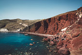 istock Red rocks and a cliff over Red beach, Santorini 1280501203