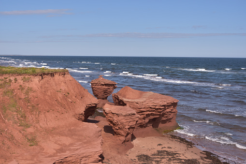 istock Red Rocks Sculpted by Tides Darnley Prince Edward Island 1094506766