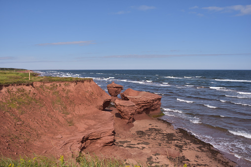 istock Red Rocks Sculpted by Tides Darnley Prince Edward Island 1094506822