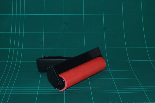 Red Roll On Cutting Mat Background Stock Photo - Download