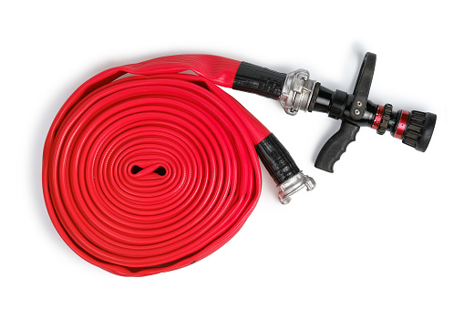 Red rolled firefighter hose isolated on the white background. Flat Lay, top view