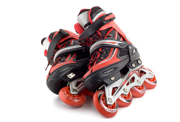 Red roller blades stock photo
