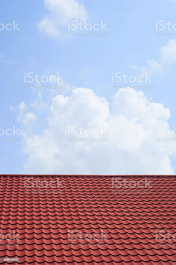 red roof and blue sky royaltyfri bildbanksbilder