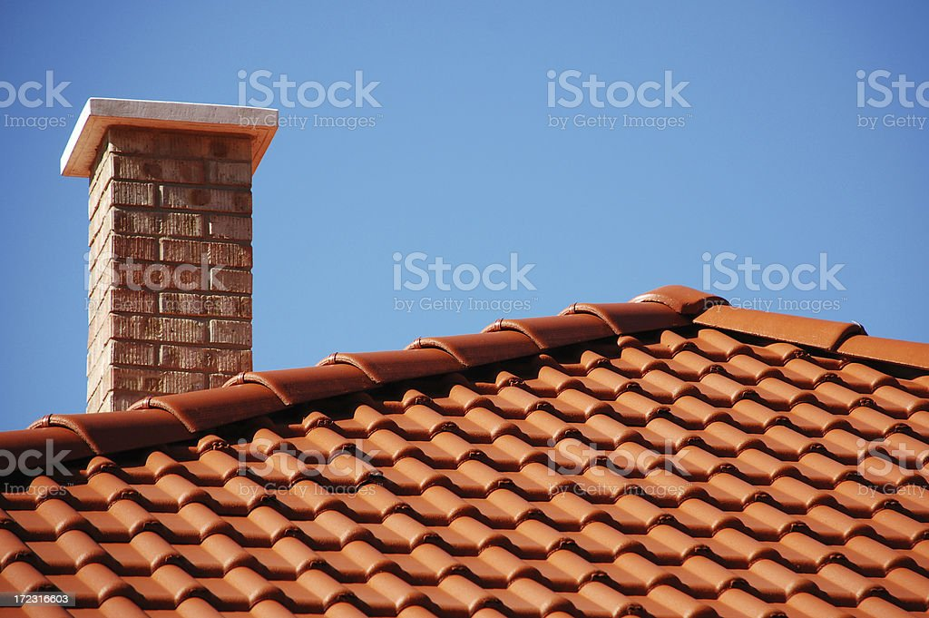 red roof and brick smoke stack stock photo
