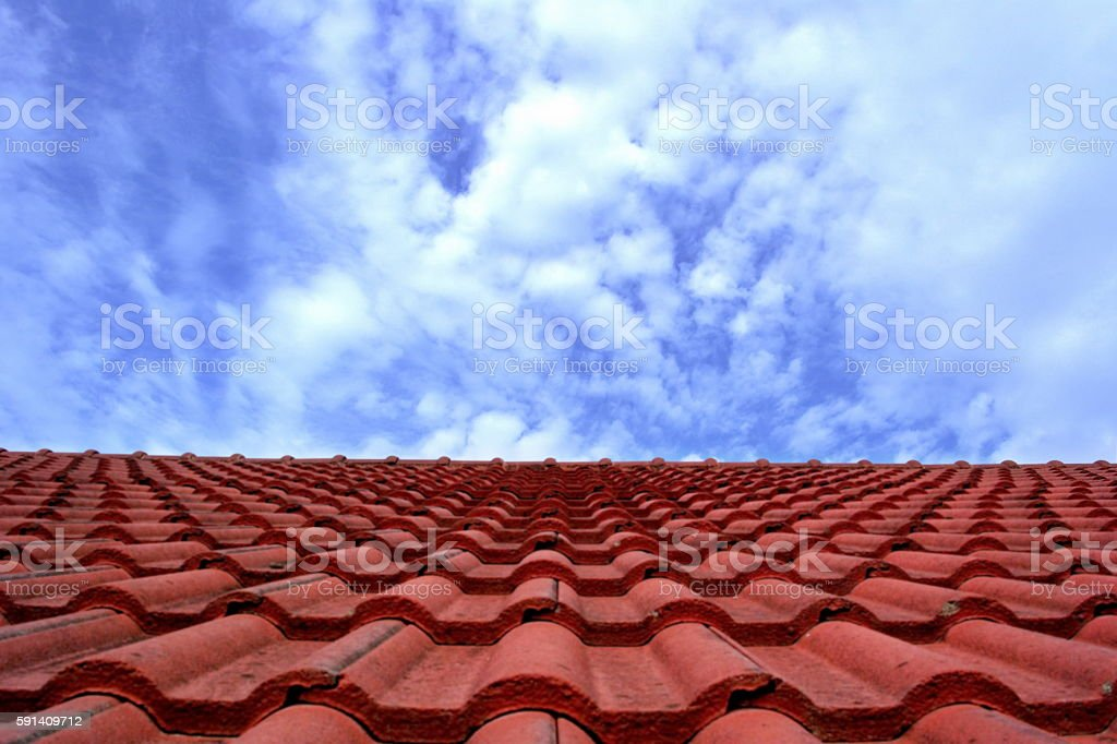 Red Roof and Sky.(Focus on Smooth Sky) stock photo