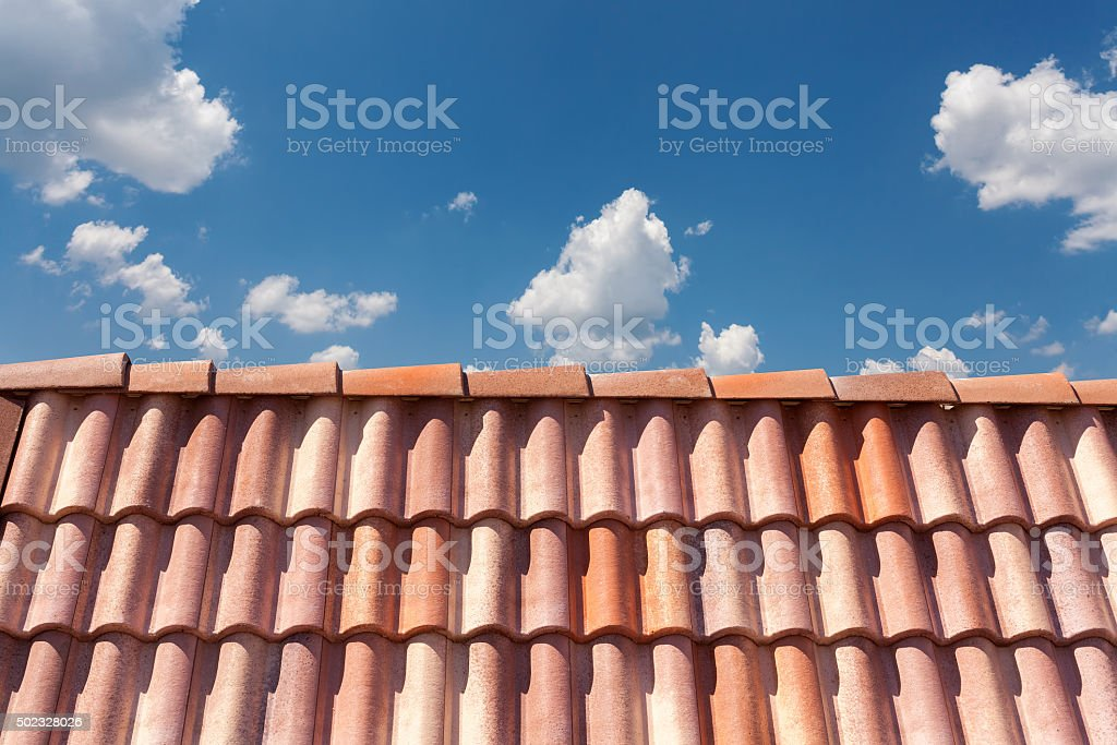 Red roof tile pattern over blue sky stock photo