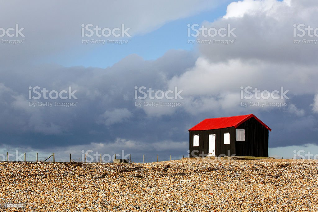 Red Roofed Hut at Rye Harbour Nature Reserve stock photo