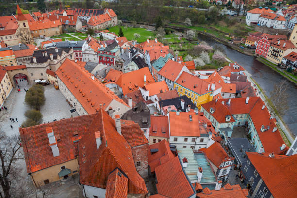 Red roofs of Cesky Krumlov, view from above. Cloudy spring weather. UNESCO World Heritage Site stock photo