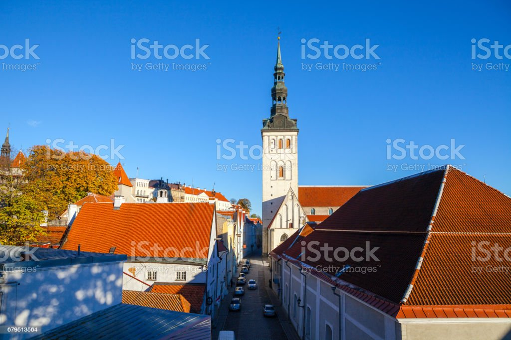 Red roofs of old Tallinn and St. Nicholas Church (Niguliste) at sunny summer day royalty-free stock photo