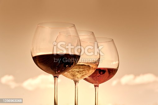Glasses, of red, rosé and white wine, at the beauty sunset. Chile.