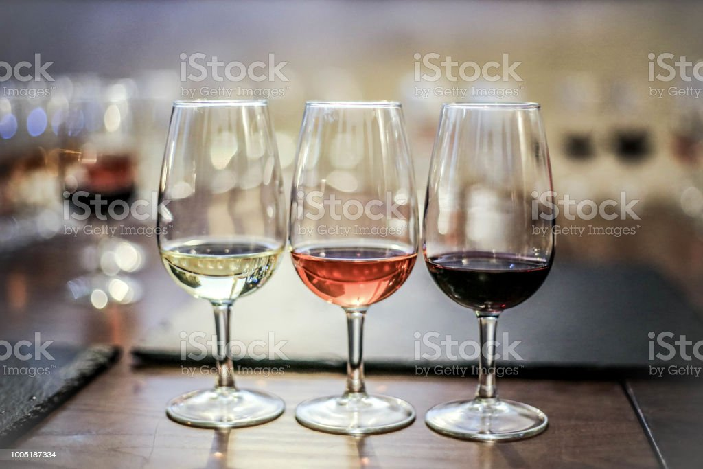Red, rosé and white wine stock photo