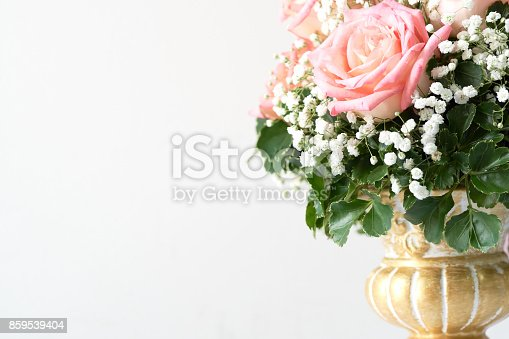 Red rose And pink beautifully arranged in a flower vase. Have romantic Decorate in important events such as wedding decoration in the building. And give it to the loved ones. copy space.
