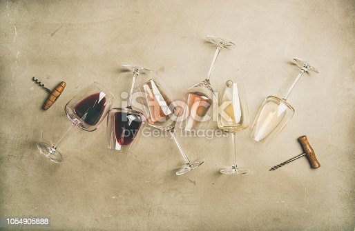istock Red, rose and white wine in glasses and corkscrews 1054905888