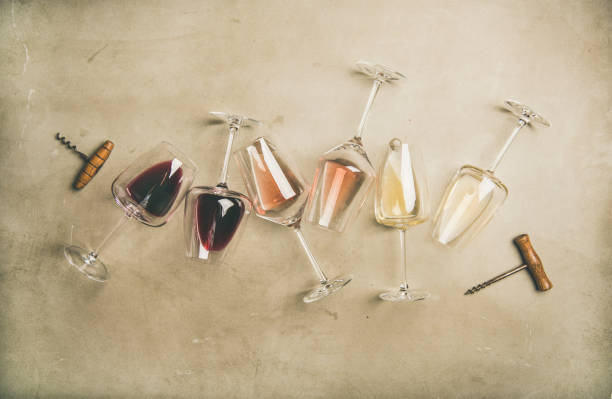 red, rose and white wine in glasses and corkscrews - assaggiare foto e immagini stock