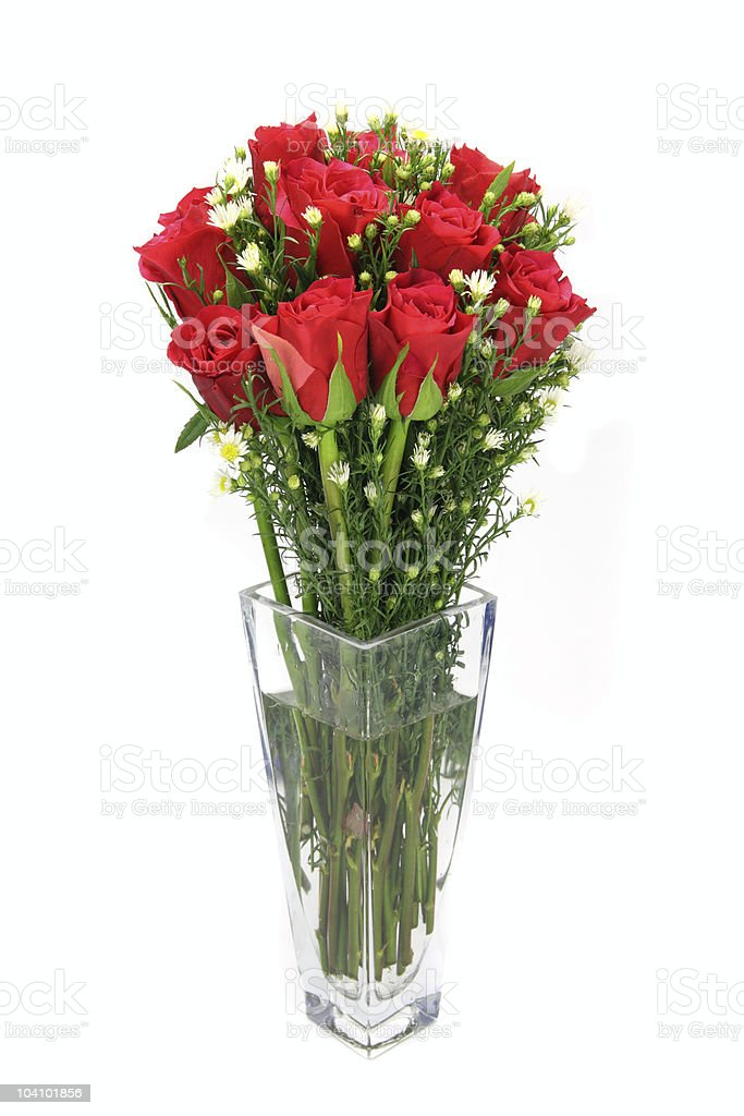 Red rose arrangement upright in a glass vase. royalty-free stock photo