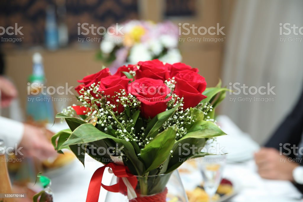Red Rose Bouquet Beautiful Green Bouquet Of Red Flowers In A Glass Vase Red Wedding Bouquet In A Glass Jar Stock Photo Download Image Now Istock
