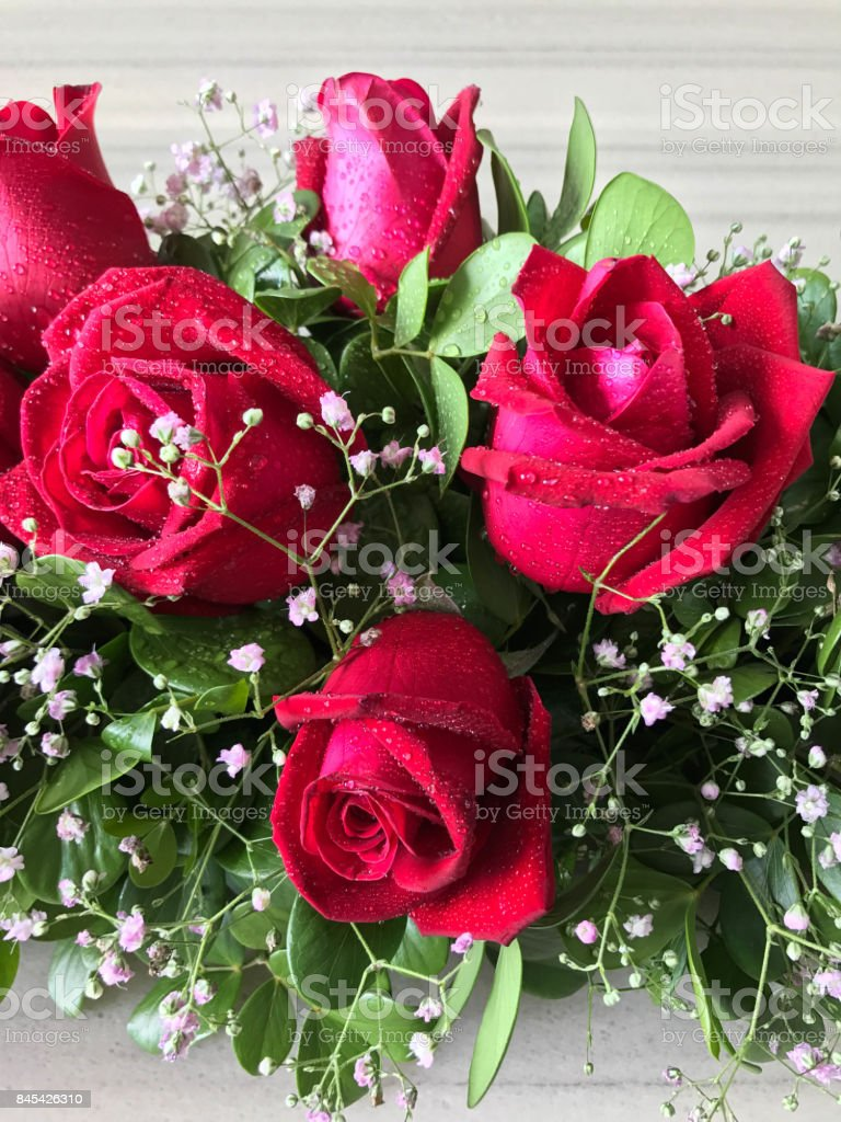 Red rose bouquet on marble dining table stock photo more pictures red rose bouquet on marble dining table royalty free stock photo izmirmasajfo