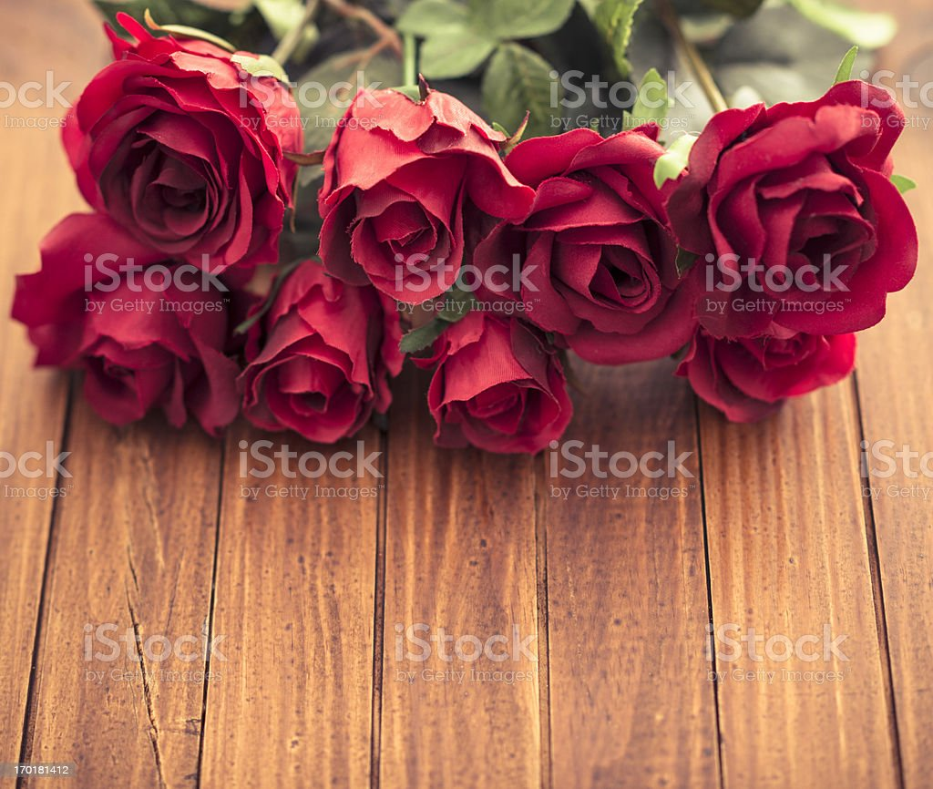 Red rose bouquet on vintage wood stock photo