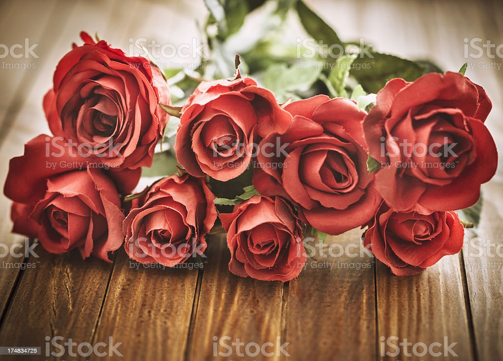Red rose bouquet on vintage wood royalty-free stock photo