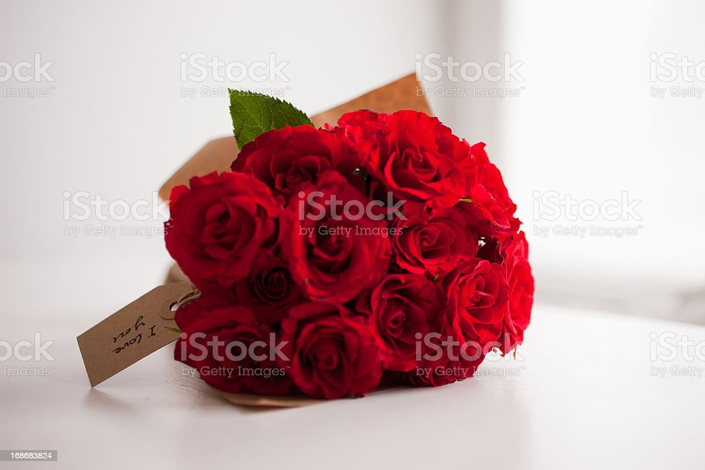 Red rose bouquet with gift tag stock photo