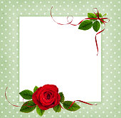 istock Red rose flower and leaves in a corner arrangement and a card 1155867439