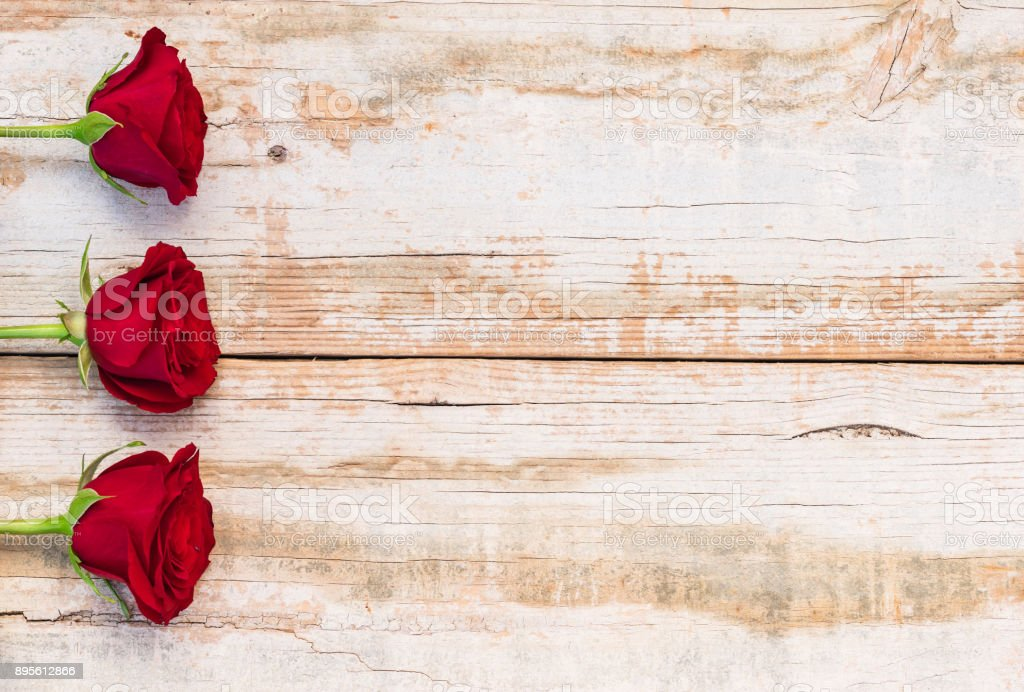 Red Rose Flowers On Rustic Wood Background Royalty Free Stock Photo
