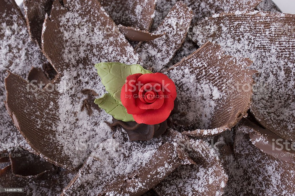 Red rose on chocolate cake royalty-free stock photo