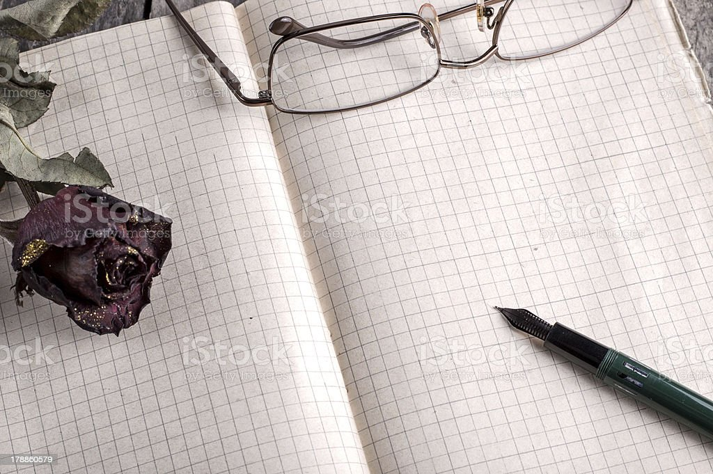 Red Rose on Old notebook royalty-free stock photo