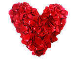 istock Red rose petals heart on white background 1196998578