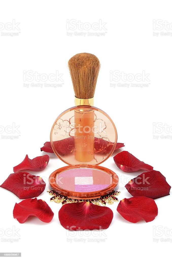 Red rose petals, items for women's makeup in a symmetrical royalty-free stock photo