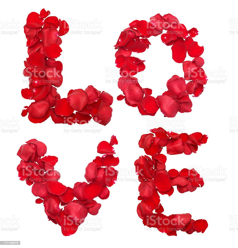 Red rose petals set in word LOVE royalty-free stock photo
