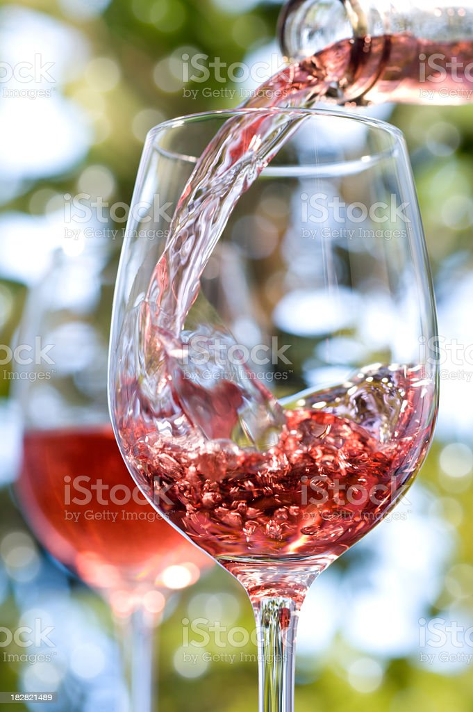 Red rose wine alfresco in glasses royalty-free stock photo