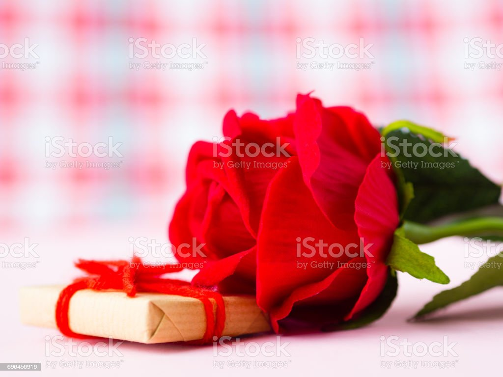 Red rose with gift box. LOVE and valentine's day concept. stock photo