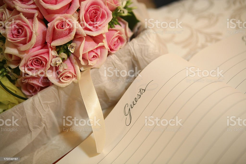 red rose with guestbook stock photo