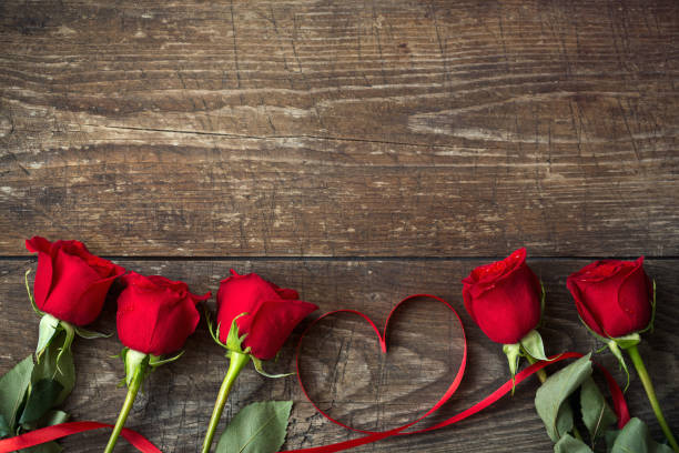 Red roses and heart shaped ribbon background picture id649669846?b=1&k=6&m=649669846&s=612x612&w=0&h=8fvt0bja3dtvylt5gz9wty7woqojlpn3x34simkvqke=