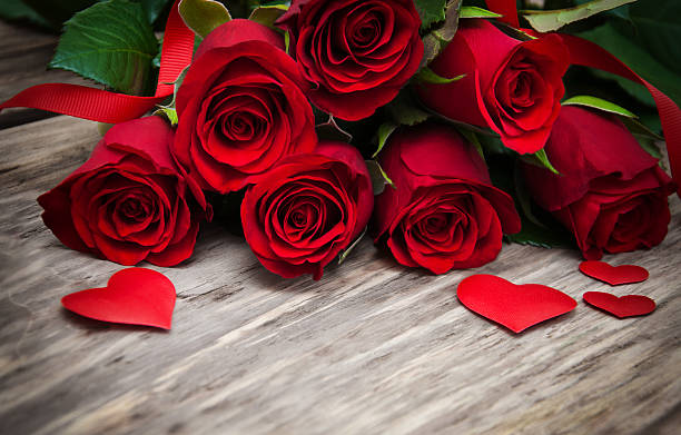 Red roses and hearts stock photo