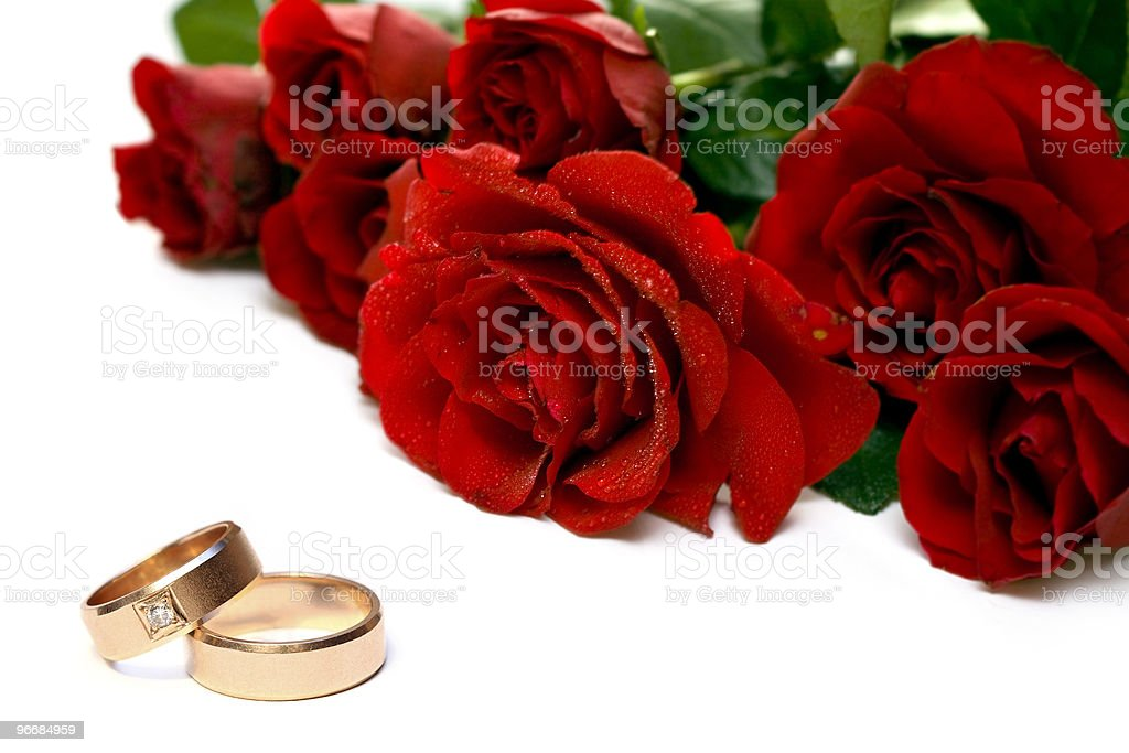 Red roses and wedding rings royalty-free stock photo