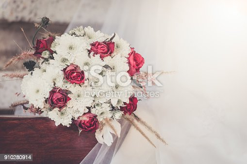 Red roses bouquet background in the wedding. Retro filter.