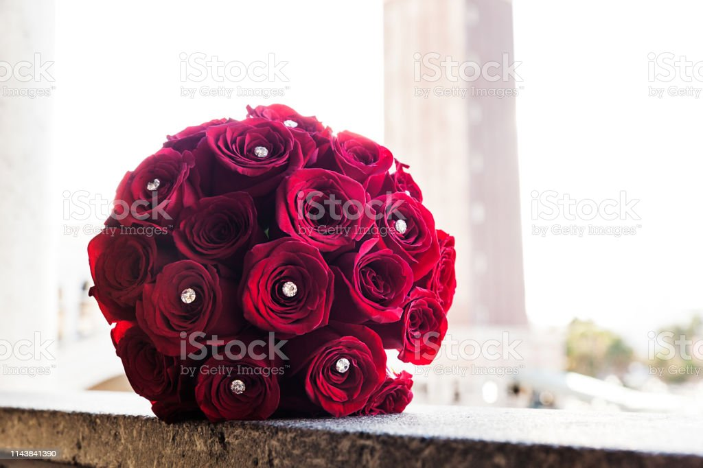 Red roses collected as a bridal bouquet on wedding day stock photo