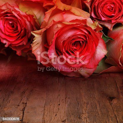 istock Red roses for a love message 640330628